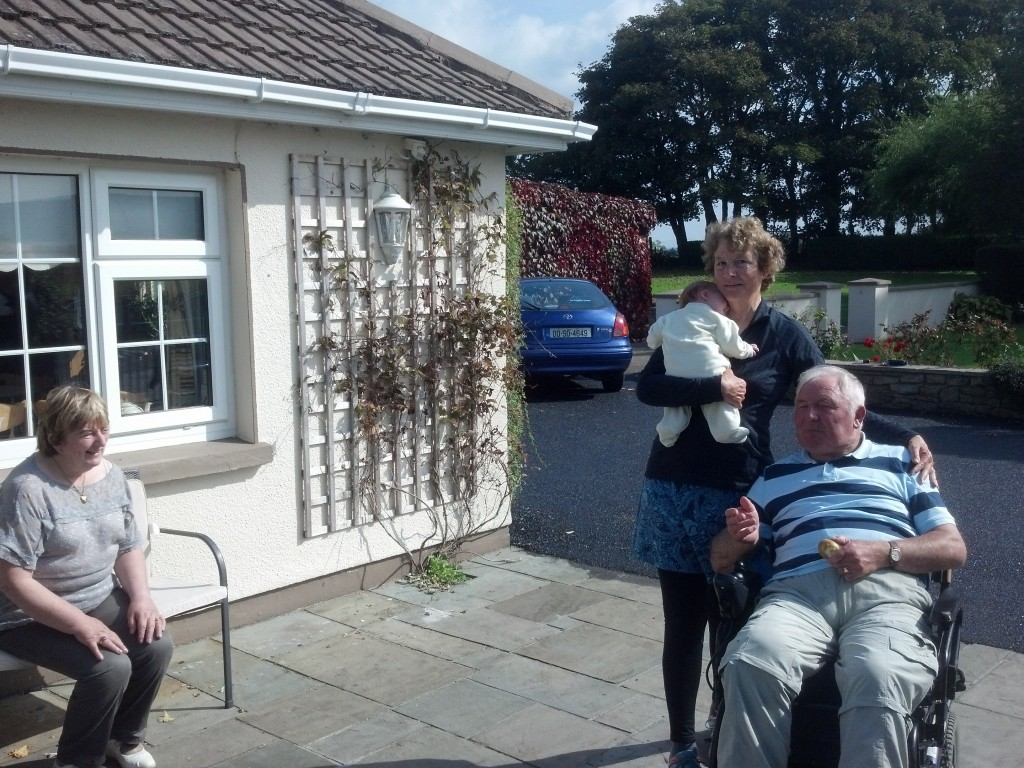 Cousin Eamon with me and his granddaughter, his wife, Pauline is on the bench.