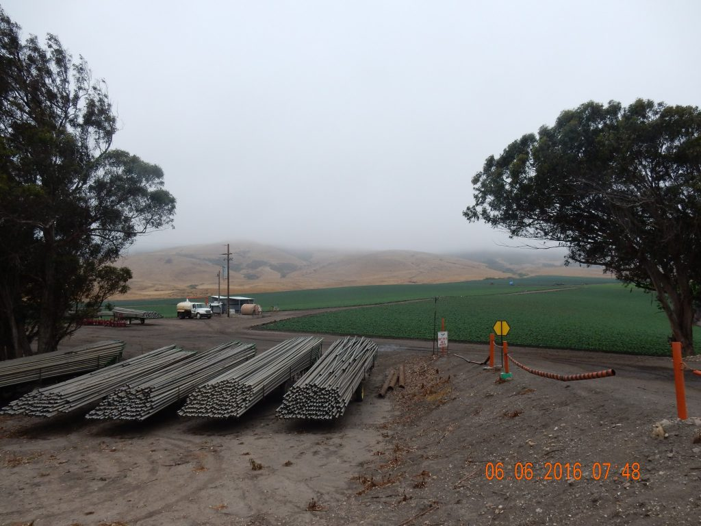 Irrigation pipes and more green fields