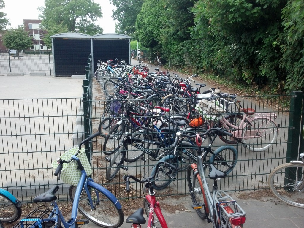 Teacher cycle parking at school in Holland