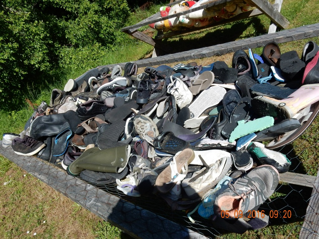 One trough filled with all kinds of shoes